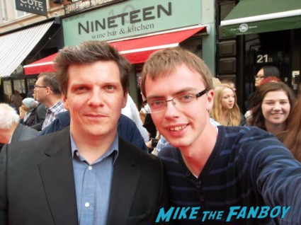 Nigel Harman signing autographs charlie and the chocolate factory theater premiere london red carpet (1)