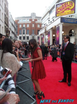 Jenna Louise Coleman signing autographs at charlie and the chocolate factory theater premiere london red carpet (20)