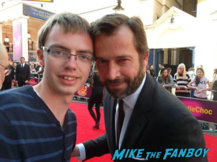 James Purefoy signing autographs for fans at charlie and the chocolate factory theater premiere london red carpet (17)