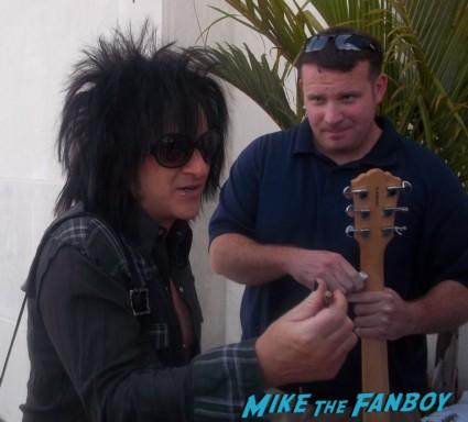 Guitarist Steve Stevens signing autographs for fans Billy Idol