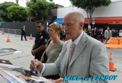 John Malkovich signing autographs for fans at  red 2 movie premiere red carpet mary louise parker autograph 009