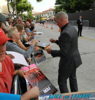 Neal McDonough signing autographs at the red 2 movie premiere red carpet mary louise parker autograph 040