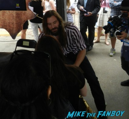Clive Standen signing autographs for fans at the vikings waterway Vikings cast group photo sdcc comic con Vikings Cast Autograph Signing At The SDCC Waterway Experience! With Travis Fimmel! Katheryn Winnick! George Blagden! Gustaf Skarsgard! Clive Standen! Jessalyn Gilsig! And More! san diego comic con 2013 signing autographs day 1 104