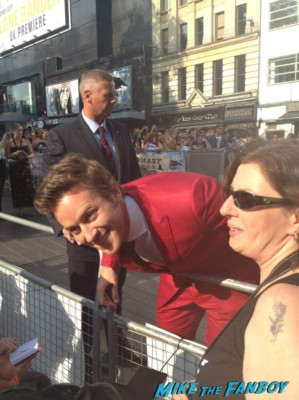 Armie Hammer signing autographs for fans at the uk premiere of The Lone Ranger