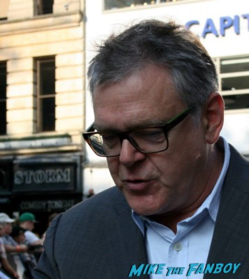 Kevin Mcnally signing autographs for fans at the uk premiere of The Lone Ranger