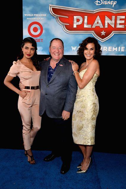 "teri hatcher and john lasseter World Premiere Of ""Disney's Planes"" - Red Carpet"