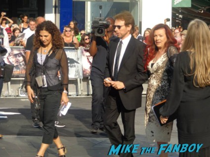 Jerry Bruckheimer signing autographs for fans at the uk premiere of The Lone Ranger
