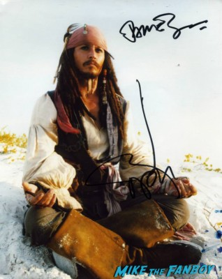 Johnny Depp signed autographed corpse bride movie poster  signing autographs for fans at the uk premiere of The Lone Ranger