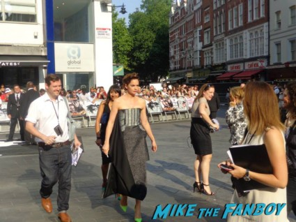 Ruth Wilson signing autographs for fans at the uk premiere of The Lone Ranger