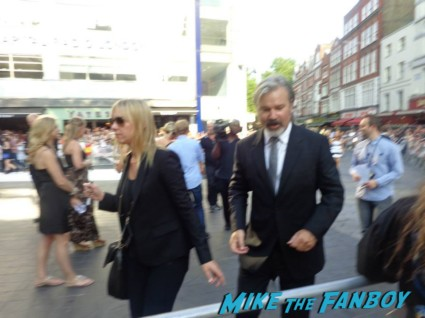 Gore Verbinski signing autographs for fans at the uk premiere of The Lone Ranger