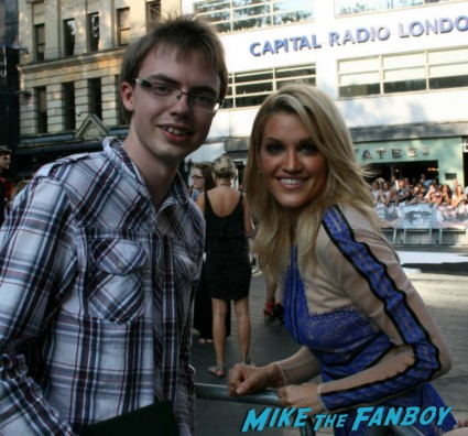 Ashley Roberts signing autographs for fans at the uk premiere of The Lone Ranger
