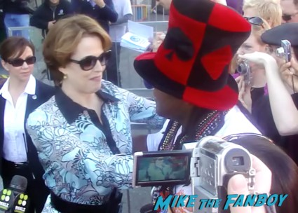 Sigourney Weaver talking to a street performer doing a rap about her