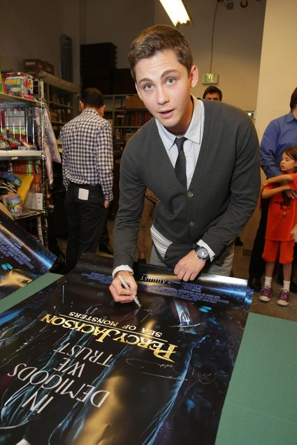 Logan Lerman on the red carpet at the percy jackson sea of monsters fan screening