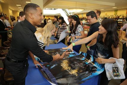 Brandon T. Jackson Logan Lerman on the red carpet at the percy jackson sea of monsters fan screening