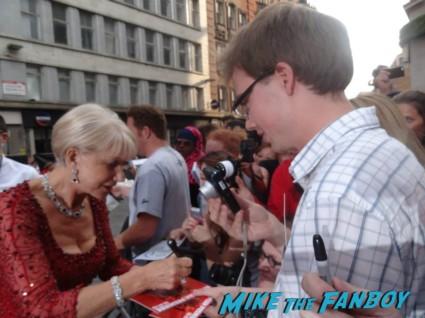 Helen Mirren signing autographs at the red 2 european movie premiere red carpet mary louise parker helen mirren (20)