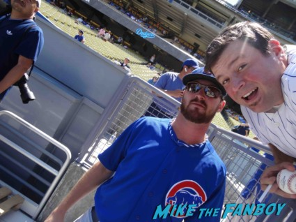 Travis Wood from the Cubs posing for a fan photo with Billy Beer