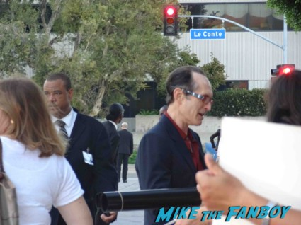 David Twohy signing autographs for fans riddick movie premiere