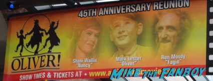 Oliver 45th Anniversay sign Mark Lester (the angelic Oliver), Shani Wallis (feisty Nancy) and Ron Moody (rascally Fagan) Event banner