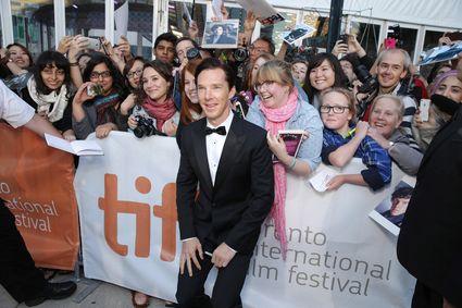 Benedict Cumberbatch Daniel Bruhl signing autographs for fans Dan Stevens Bill Condon, Stacey Snider, Benedict Cumberbatch, Daniel Bruhl The Fifth Estate TIFF World Premiere red carpet Benedict cumberbatch