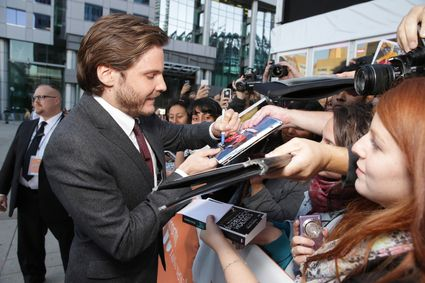 Daniel Bruhl signing autographs for fans Dan Stevens Bill Condon, Stacey Snider, Benedict Cumberbatch, Daniel Bruhl The Fifth Estate TIFF World Premiere red carpet Benedict cumberbatch