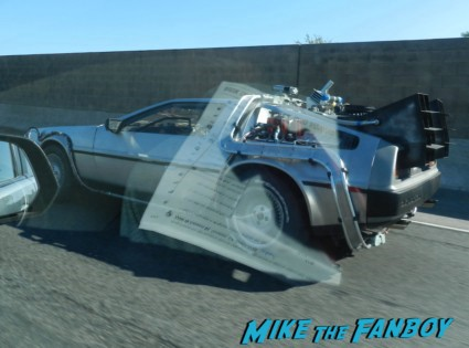 back to the future dolorean driving on the road