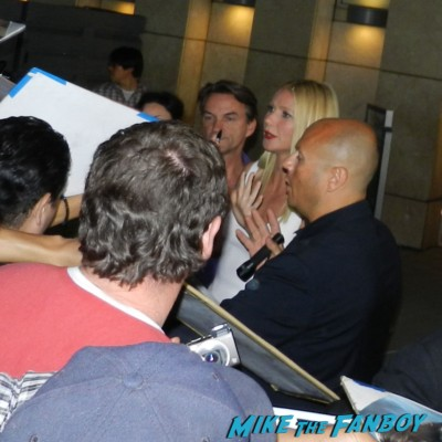Gwyneth Paltrow signing autographs for fans Thanks for sharing movie premiere Gwyneth Paltrow red carpet pink tim robbins