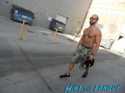sexy shirtless muscle bodybuilder walking around hollywood blvd.