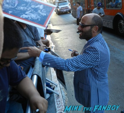 Michael Ornstein signing autographs for fans sons of anarchy season 6 premiere red carpet charlie hunnam 017