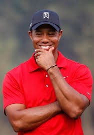 tiger woods smiling at the golf course
