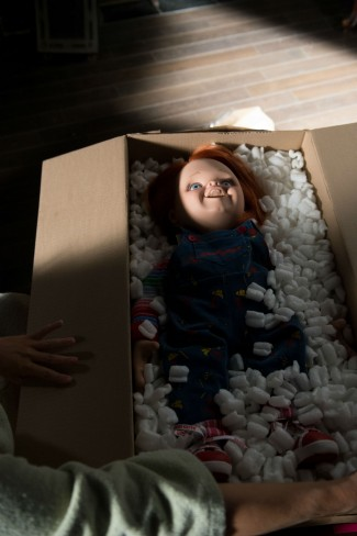 curse of chucky doll arriving in a box