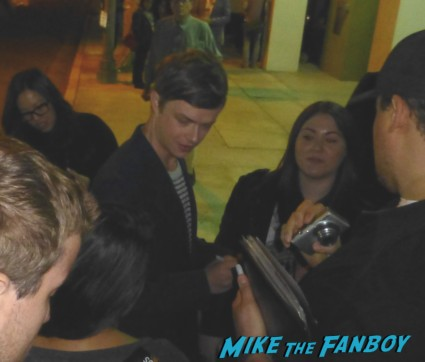 Dane DeHaan signing autographs for fans kill your darlings movie premiere