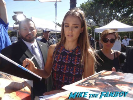 Jessica Alba signing autographs taping an interview for Extra at universal studios