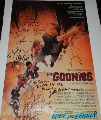 The Goonies mini poster signed autograph sean astin josh brolin corey feldman martha plimpton Jonathan Ke Huy Quan signing autographs for fans at hollywood show julie newmar signing autographs catwoman barbie 009