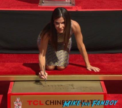 sandra bullock handprint ceremony signing autographs gravity (1)