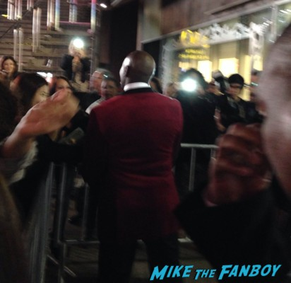 Morris Chestnut Sanaa Lathan Terrence Howard signing autographs for fans iron man The best man holiday movie premiere marquee