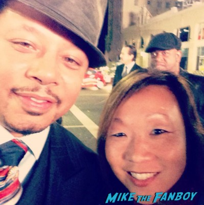 Terrence Howard signing autographs for fans iron man The best man holiday movie premiere marquee