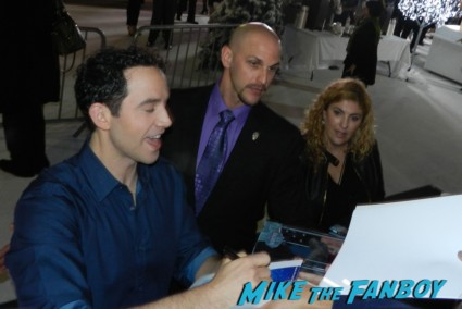 Santino Fontana signing autographs frozen movie premiere los angeles red carpet 031