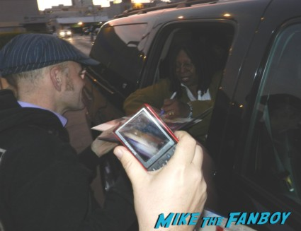 whoopie goldberg signing autographs for fans 001
