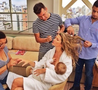 Gisele breast feeding her baby