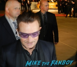 Bono signing autographs at the Palm Springs International Film Festival 2014 signing autographs bono sandra bullock