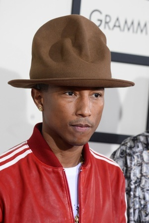 Pharrell Williams arrives at the 56th annual GRAMMY Awards at Staples Center on Sunday, Jan. 26, 2014, in Los Angeles. (Photo by Jordan Strauss/Invision/AP)