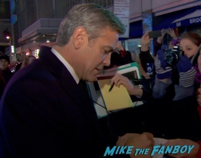 george clooney signing autographs hot Monuments Men New York Movie Premiere signing autographs george clooney 2