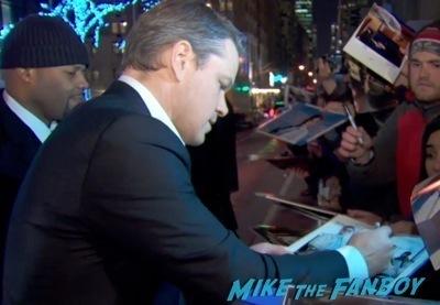 matt damon  signing autographs hot Monuments Men New York Movie Premiere signing autographs george clooney 2