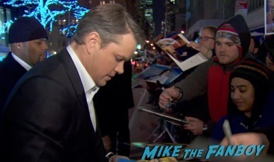 matt damon signing autographs hot Monuments Men New York Movie Premiere signing autographs george clooney 2