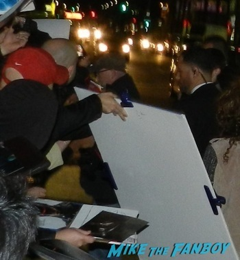 Jackie Earle Haley signing autographs Robocop movie premiere los angeles red carpet 12