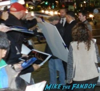 Jackie Earle Haley signing autographs Robocop movie premiere los angeles red carpet 12