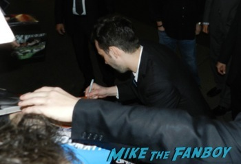 Jay Baruchel signing autographs Robocop movie premiere los angeles red carpet 20