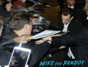 Jay Baruchel signing autographs Robocop movie premiere los angeles red carpet 20