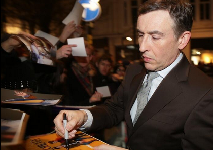 Steve Coogan signing autographs for fans BAFTA pre award show party