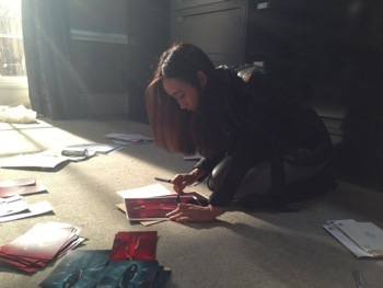 Maggie Q  signing autographs fanmail